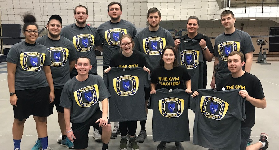 Team holding up intramural champion shirts