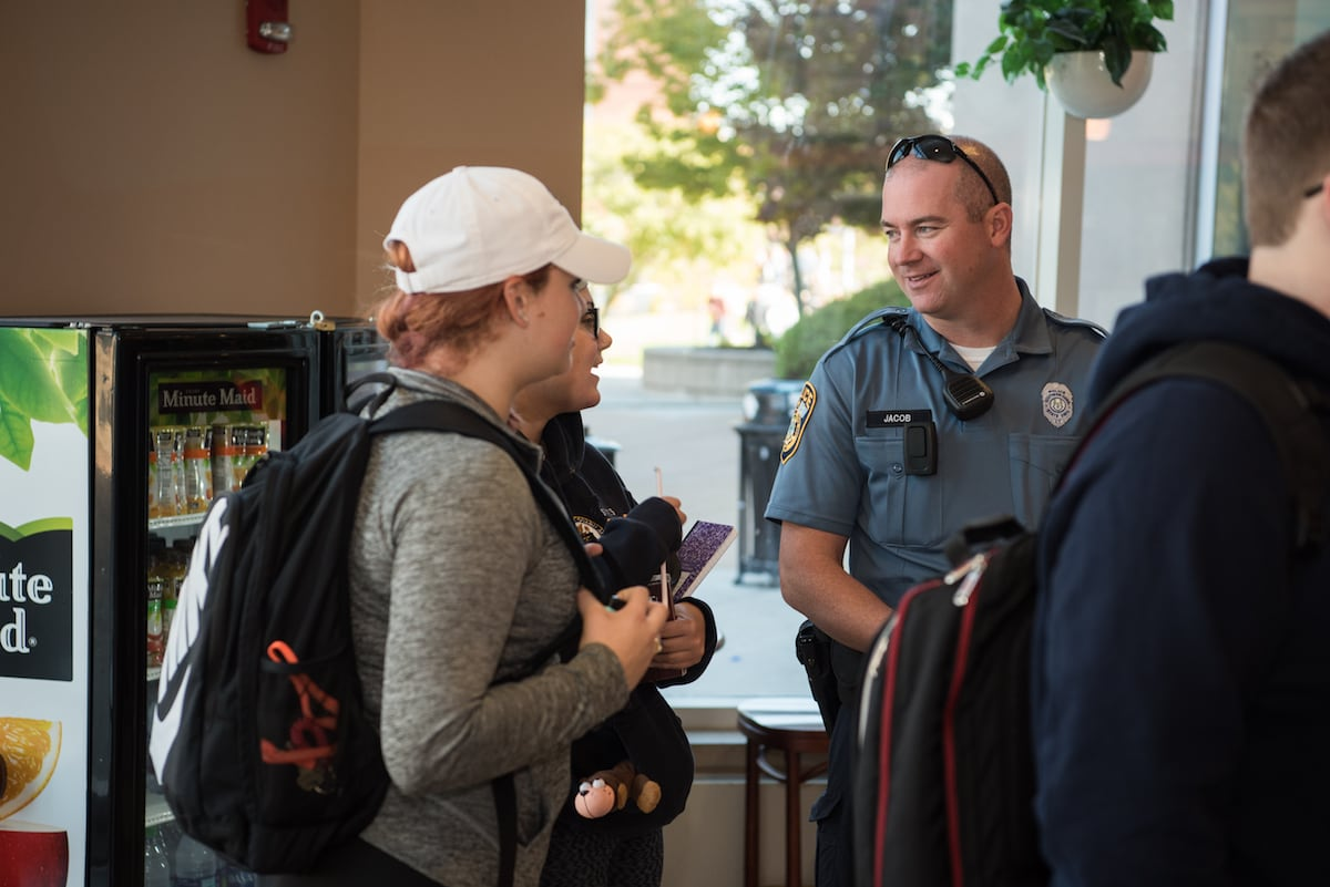 University Police officer in conversation with students