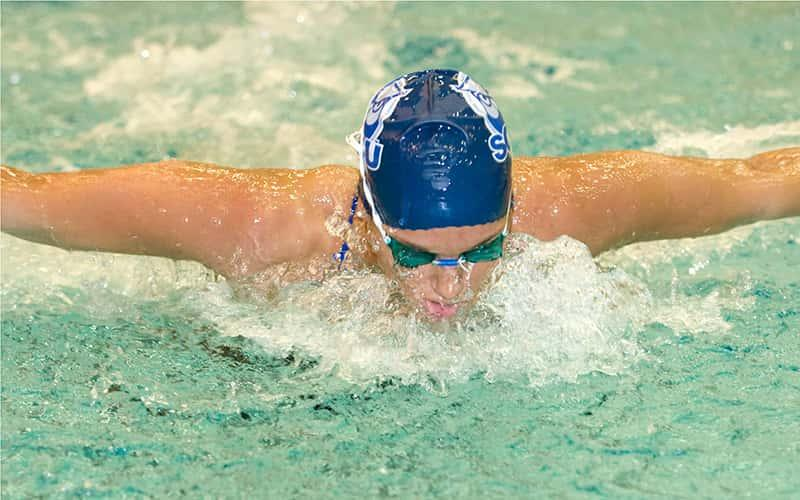 alumna swimmer Kristen Frost, '10, swims the butterfly