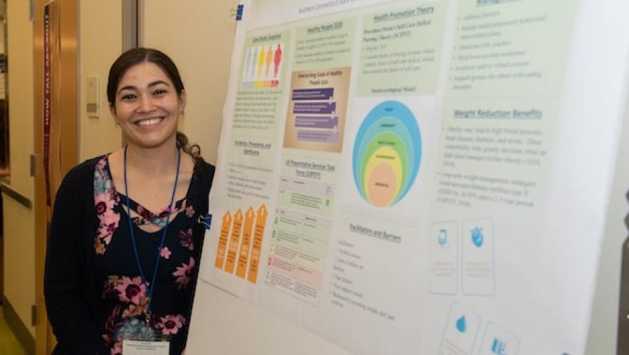 Woman with graduate research project