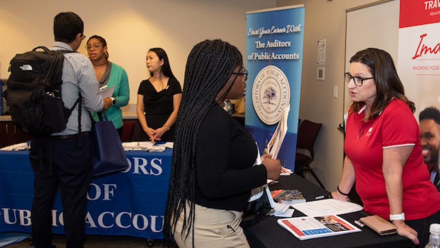 People discussing during a career fair