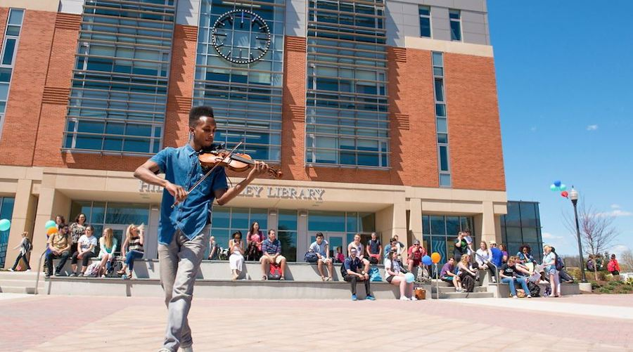 Violinist playing in front of Buley Library